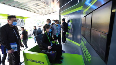 A Zoomlion employee demonstrates its 5G Tower Crane Remote Intelligent Control System at the 2021Changsha InternationalConstruction Equipment Exhibition (CICEE)